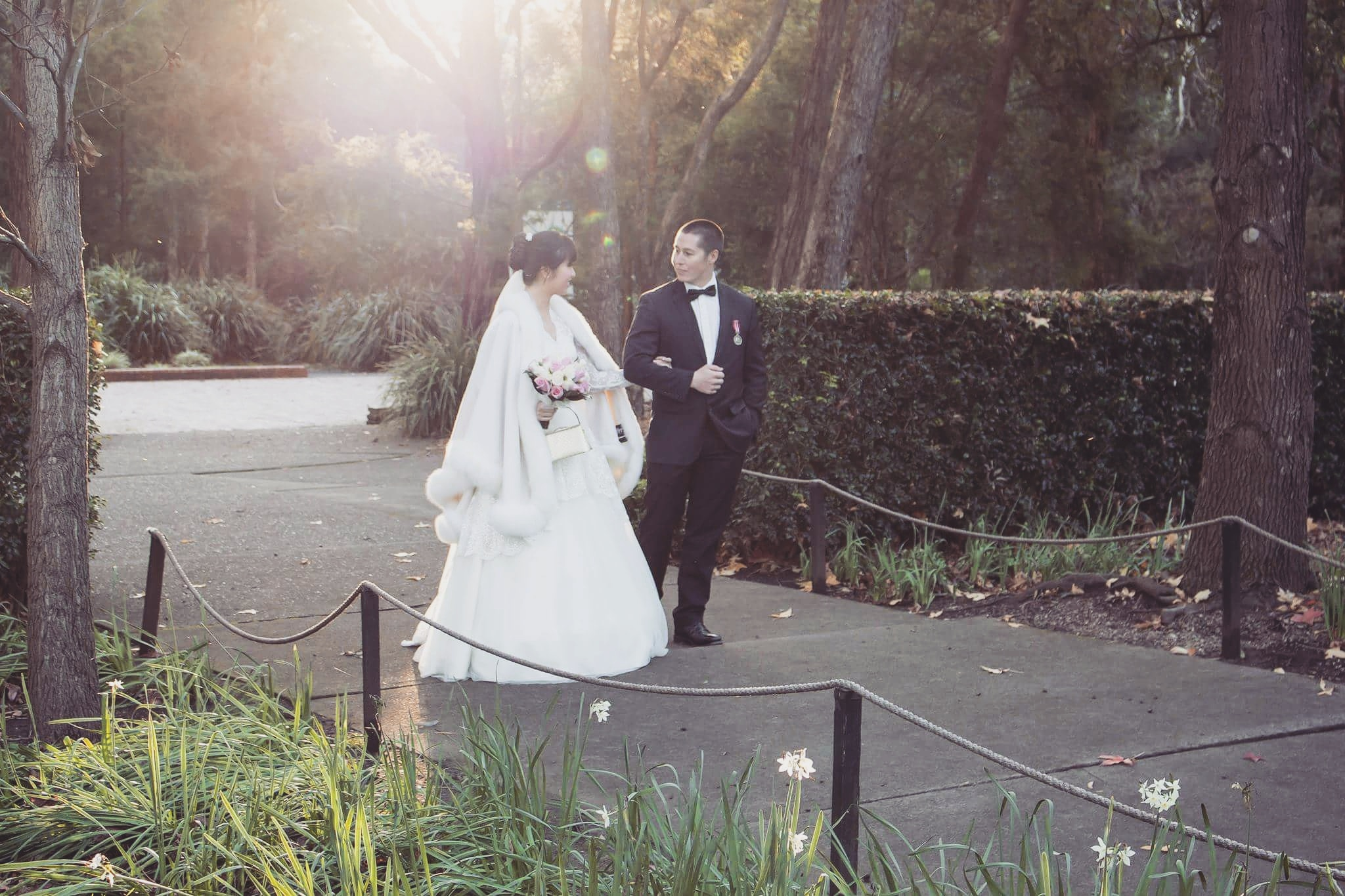 Australian and asian wedding couple walking at auburn botanic gardens