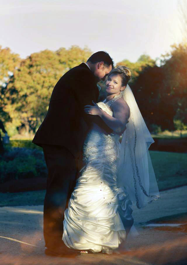 A groom and bride pose for the camera sydney wedding hunter valley